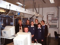 Andrew Cowley demonstrates the Nonius Kccd diffractometer to the Science Club. There is a second diffractometer behind the group.