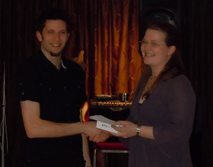 Kirsten presents Nick with his prize